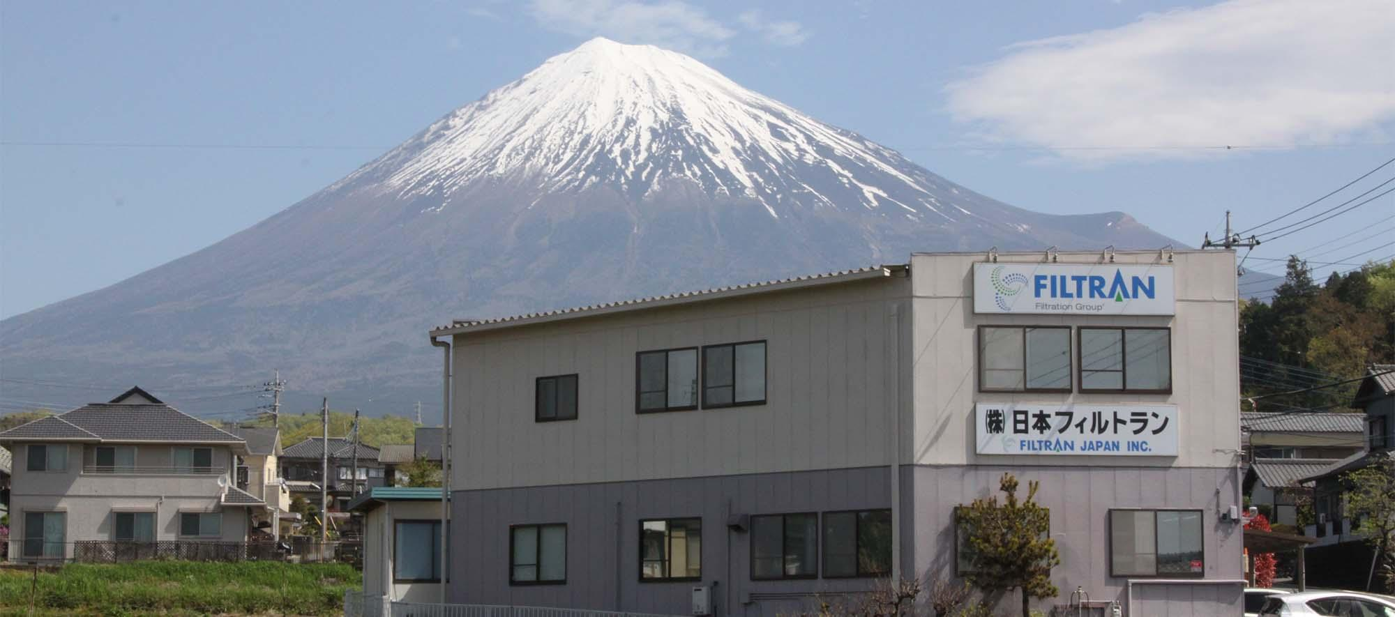 building in japan with mt fuji in background