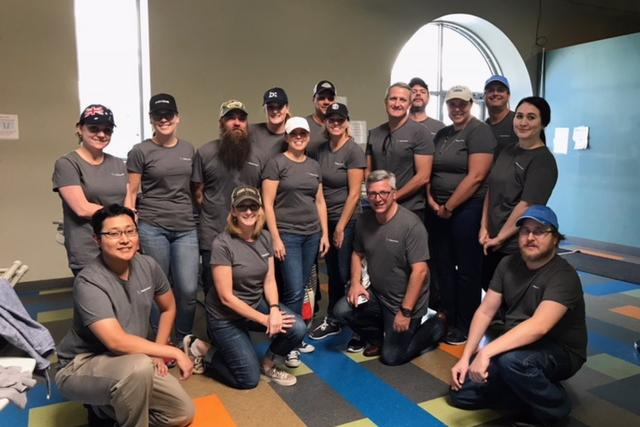 Group photo of Filtration employees helping serve meals