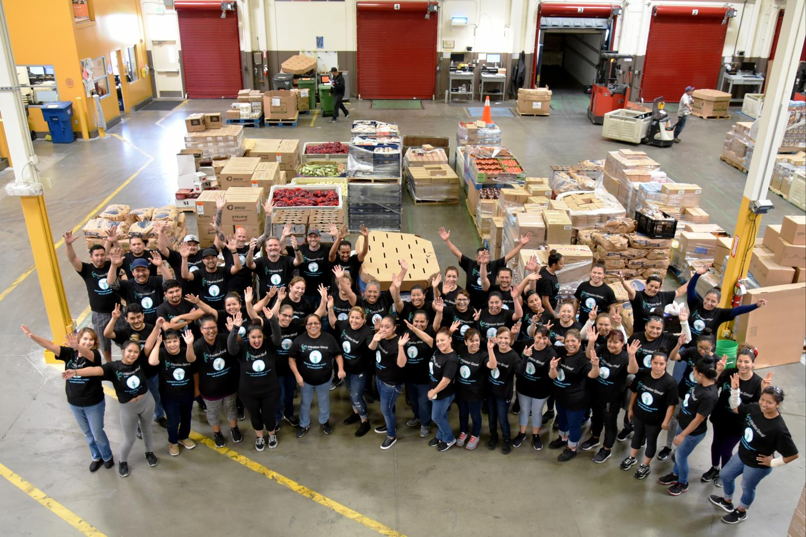 overhead shot of filtration group employees in food distribution center