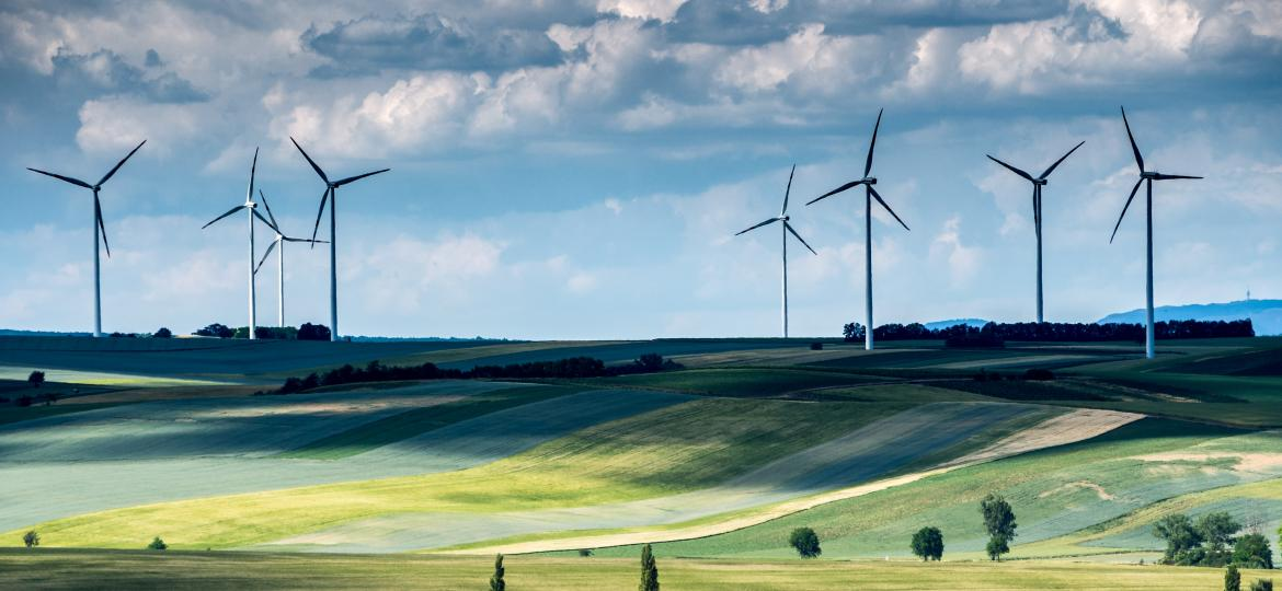 Wind turbines across a green field