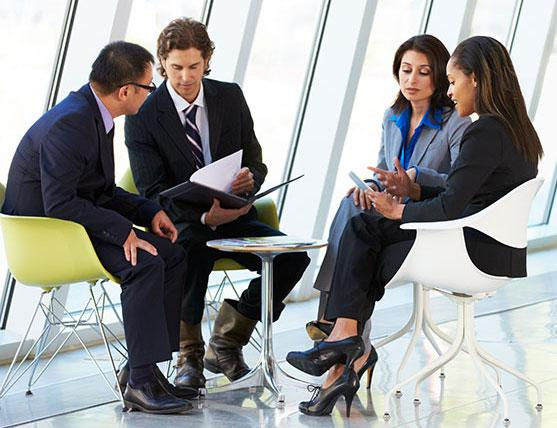 business leaders meeting around table